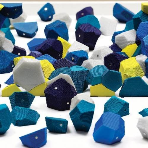 Abstract 3D puzzle with blue, yellow, white, turquoise