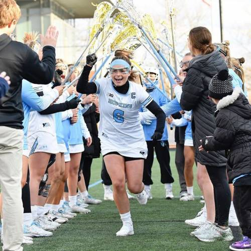Women's lacrosse player with teammates