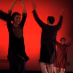 Dance performance with red backdrop