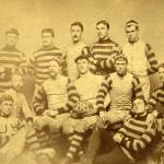 Sepia tone photo of 12 members of the 1888 football team in striped jerseys
