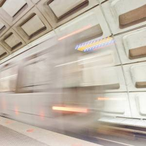 Blurred image of Washington D.C. metro arriving at underground station