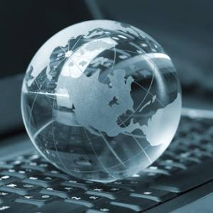 Small glass globe on top of computer keyboard