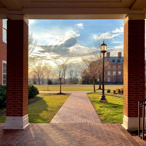 Brick walkway on campus with clouds in the background